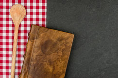 Wooden spoon and cookbook Stock Photo