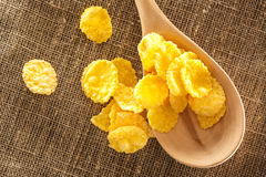 Wooden spoon and corn flakes Stock Photo