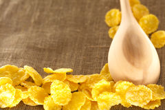 Wooden spoon and corn flakes Royalty Free Stock Photography