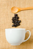 Wooden spoon and a cup of coffee Stock Photos