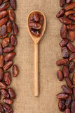 Wooden spoon with date Stock Photo