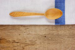 Wooden spoon and dishcloth Stock Photo