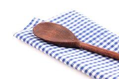 Wooden spoon on dishtowel Royalty Free Stock Photos