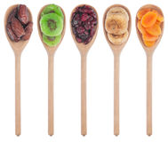 Wooden spoon with dried apricots, figs, dates, kiwi and cranberr Stock Photo