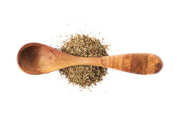 Wooden spoon and dried basil Royalty Free Stock Photos