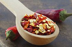 Wooden spoon with dried crushed chili red pepper Royalty Free Stock Photography