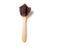 Wooden Spoon with dried dates Royalty Free Stock Photo