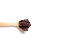 Wooden Spoon with dried dates Royalty Free Stock Images