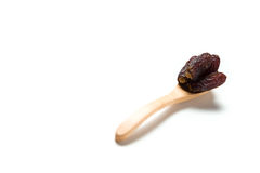 Wooden Spoon with dried dates Stock Images