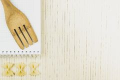 Wooden spoon and dried noodles butterfly stock images