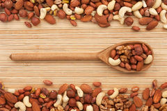 Wooden spoon with  dried  nuts Royalty Free Stock Images
