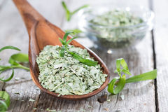 Wooden spoon with dried Tarragon Royalty Free Stock Images