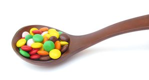 Wooden spoon filled with candy Stock Image
