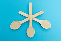 Wooden spoon filled with dry yeast isolated over the blue background.  stock photos