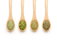 Wooden Spoon filled with herbs Stock Image