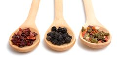 wooden spoon filled with various spices isolated royalty free stock photo