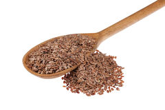 Wooden spoon with flax seeds Stock Photography