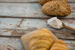 Wooden spoon with flour and bread Stock Photos