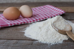 Wooden spoon with flour Stock Images