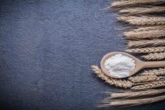 Wooden spoon flour wheat rye ears horizontal version Stock Photo