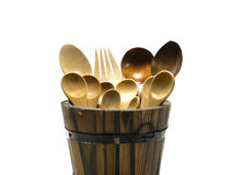 Wooden spoon and fork in barrel on isolate background. Wooden spoon and fork in barrel Royalty Free Stock Image