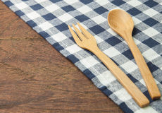 Wooden spoon and fork with blue tablecloth Royalty Free Stock Images