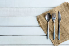 Wooden spoon and fork with dish on white wood Royalty Free Stock Photography