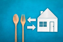 Wooden Spoon and fork with house paper cut icon Stock Photos