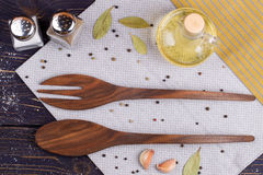 Wooden spoon and fork on a kitchen towel. Top view Royalty Free Stock Photo
