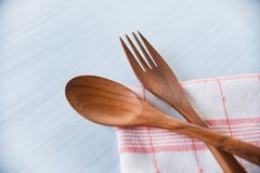 Wooden spoon and fork kitchenware set on napery on dining table - Zero waste use less plastic concept royalty free stock image
