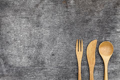 Wooden spoon and fork, knife. On grunge wood background Royalty Free Stock Photo