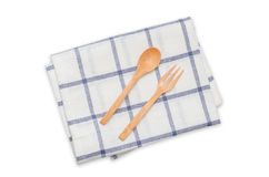 Wooden spoon and fork on napkin. Isolated on white with clipping path Royalty Free Stock Photos