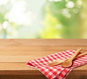 Wooden spoon and fork on napking on table. Wooden spoon wood fork table color red Royalty Free Stock Image