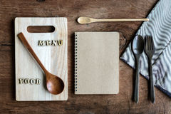 Wooden spoon and fork with note on old wooden background Stock Photography