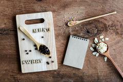 Wooden spoon and fork with note on old wooden background Royalty Free Stock Images