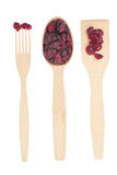 Wooden spoon, fork, paddle with cranberry Stock Photo