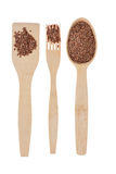 Wooden spoon, fork, paddle with  flax seed Royalty Free Stock Photography