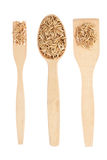 Wooden spoon, fork, paddle with oat Royalty Free Stock Images