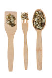 Wooden spoon, fork, paddle with pumpkin  seed Royalty Free Stock Images