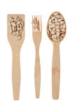 Wooden spoon, fork, paddle with pumpkin  seed Stock Images