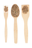 Wooden spoon, fork, paddle with rye Royalty Free Stock Image