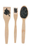 Wooden spoon, fork, paddle with sunflower  seed Royalty Free Stock Photo