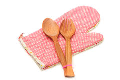 Wooden spoon and fork with quilted heat protective mitten Royalty Free Stock Photos
