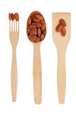 Wooden spoon,fork, shovel with almonds Stock Image