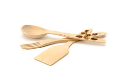 Wooden spoon, fork, spatula. Stock Photos