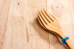 Wooden spoon and fork on table Royalty Free Stock Images