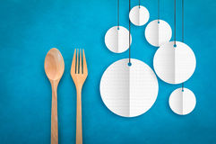 Wooden Spoon and fork with white round banner.jpg Royalty Free Stock Photos