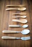 Wooden spoon and fork. On wood backgrounds royalty free stock photography