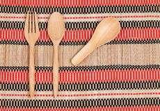 Wooden spoon and fork on wood texture Royalty Free Stock Photography