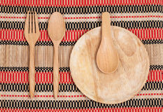 Wooden spoon and fork on wood texture Stock Images